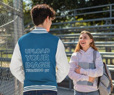 Varsity Jacket Mockup Featuring a Man Talking to a Friend 33209
