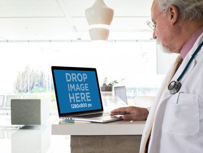 Mockup of a Senior Male Doctor with a MackBook at a Hospital 12442