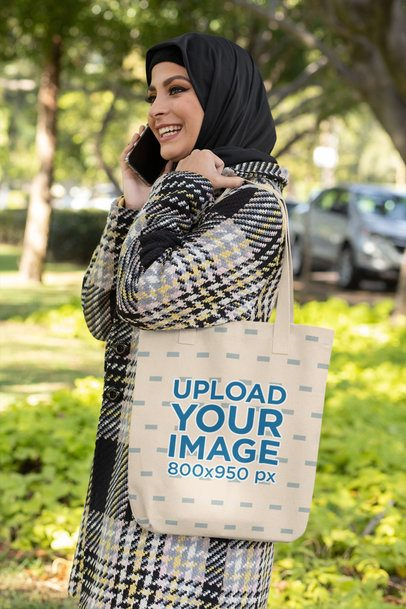 Tote Bag Mockup of a Happy Woman Talking on the Phone 32408