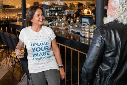 T-Shirt Mockup of a Middle-Aged Woman Having Fun at a Bar 32877
