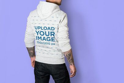 Mockup of the Back of a Man Wearing a Heather Hoodie at a Studio 3580-el1