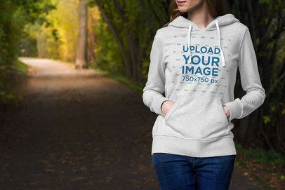 Hoodie Mockup of a Woman Walking by a Park Lane 3562-el1