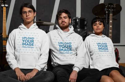 Hoodie Mockup of Three Musicians Sitting in Front of Their Instruments 33329
