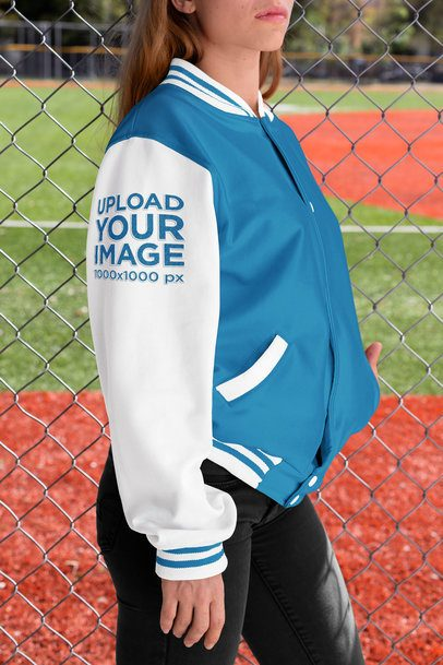 Varsity Jacket Mockup of a Woman Showcasing Her Sleeve 33212