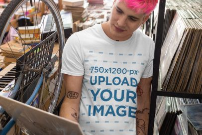 T-Shirt Mockup Featuring a Tattooed Man Looking at a Vinyl Record 33312