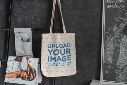 Mockup Featuring a Sublimated Tote Bag Hanging From a Dar Metal Rack 3143-el1
