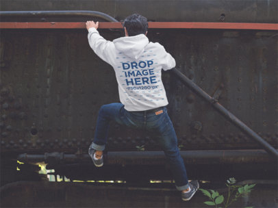 Hoodie Mockup (Back) Featuring a Young Man Climbing c12496