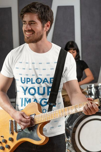 T-Shirt Mockup Featuring a Man Playing the Guitar 33333