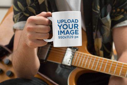Mockup of a Musician Holding an 11 oz Coffee Mug 33324