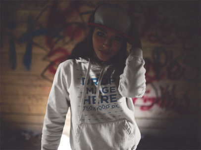 Trendy Girl with a Hat and Hoodie Mockup in the Dark b12484