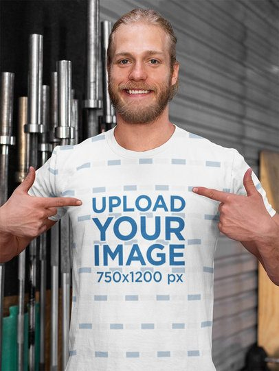 Mockup of a Man Showing His Sublimated Tee in Front of the Bars at a Gym 33056