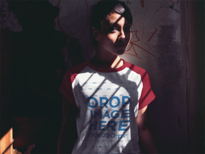 Pretty Girl Wearing a Raglan Tee Mockup Standing in the Shadow a12509