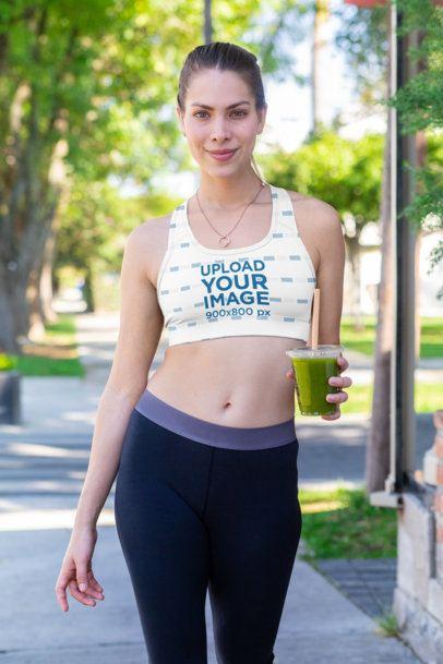 Sports Bra Mockup of a Woman Walking Down the Street 32770