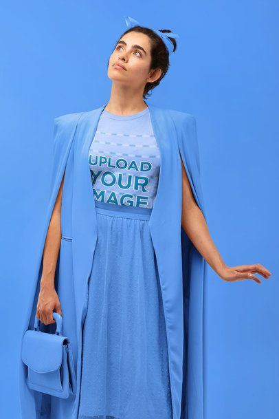 T-Shirt Mockup Featuring a Woman with a Stylish Outfit at a Studio 32839