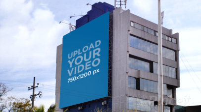Video Featuring a Billboard Attached to a Building's Wall 32972