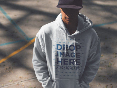 Hoodie Mockup of a Guy Wearing a Hat and Hiding in the Shadow c12499