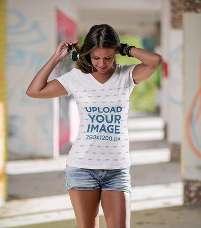 Mockup Featuring a Woman Wearing a Customizable V-Neck T-Shirt 3688-el1