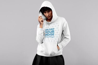 Pullover Hoodie Mockup Featuring an Androgynous Woman at a Studio 32926