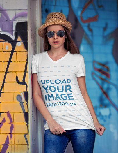 Mockup of a Woman Wearing a V-Neck T-Shirt and Posing by Graffitied Walls 3680-el1