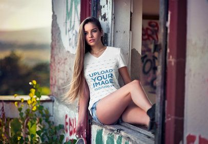 V-Neck Tee Mockup of a Woman Sitting on the Window of an Old Building 3681-el1