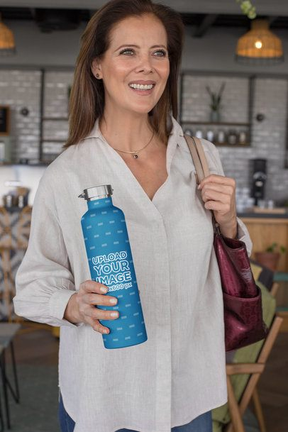 Aluminum Bottle Mockup of a Woman at a Coffee Store 33527