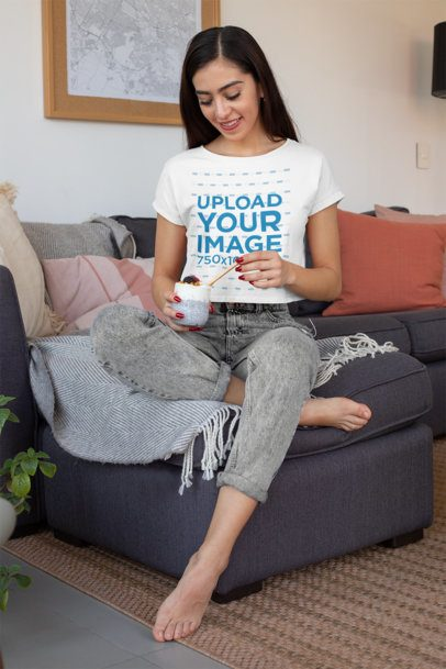Crop Top Tee Mockup Featuring a Young Woman Eating at Home 32759