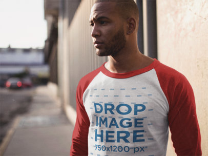 Raglan Tee Mockup of a Serious Young Man in the Street a12557a