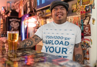 Mockup of a Tattooed Man with a T-Shirt Smiling at a Bar 32850