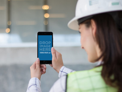 Black iPhone 6 Plus Held by a Female Architect at the Construction Site a12580