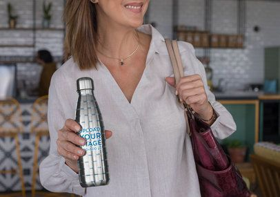 Mockup of a Woman Holding an Aluminum Bottle 33526