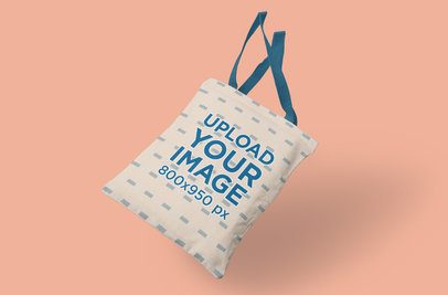 Mockup Featuring a Tote Bag Falling Against a Solid Color Backdrop 3121-el1