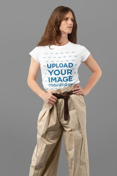 Mockup Featuring a Long-Haired Woman Wearing a Customizable T-Shirt at a Studio 32940