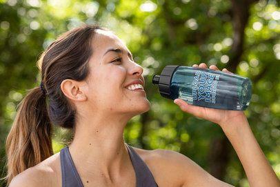 Mockup of a Happy Woman Drinking from a Bike Bottle 33511