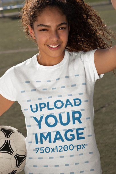 T-shirt Mockup of a Teen Girl Taking a Selfie with a Soccer Ball 33579