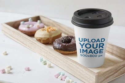 Mockup of a Paper Coffee Cup Place Next to Some Donuts 3781-el1