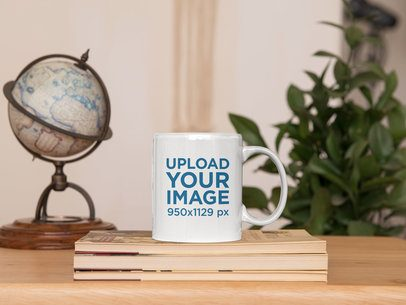 Sticker Mockup Featuring an 11 oz Mug on a Set of Books 33615
