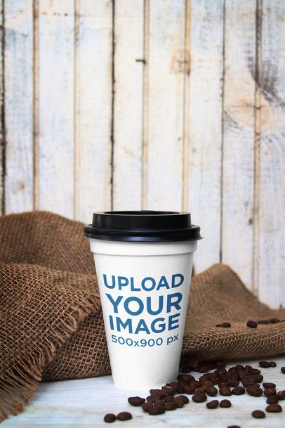 Mockup of a Paper Cup Placed by a Gunny Sack and Some Coffee Beans 3756-el1