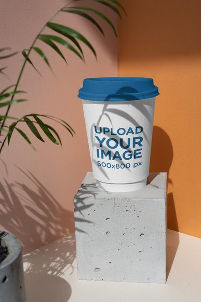 Coffee Cup Mockup Featuring a Little Plant 3768-el1