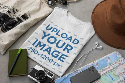 T-Shirt Mockup Surrounded by Travel Accessories 33680