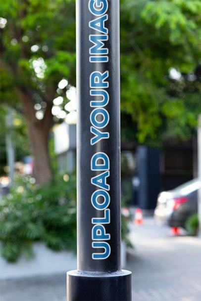 Mockup of a Sticker Placed on a Light Pole 33611