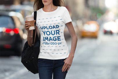 T-Shirt Mockup of a Woman Walking Down a Busy Street 3361-el1