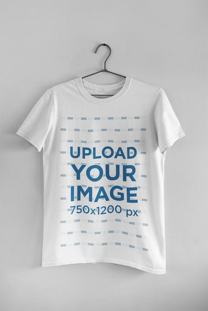 Mockup of a Basic Round Neck Tee Hanging on a Wall 33734
