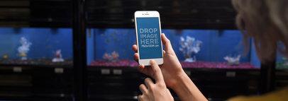 iPhone 6 Mockup of a Woman at an Aquarium 12808WIDE