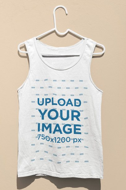 Mockup of a Tank Top Hanging Against a Wall 33694