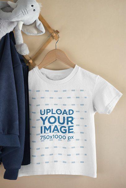 Mockup of a Kid's T-Shirt Hanged Next to a Stuffed Animal 33691