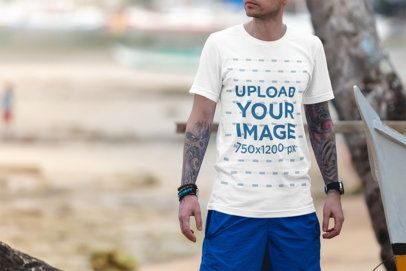 T-Shirt Mockup of a Man Hanging out at the Beach 3324-el1
