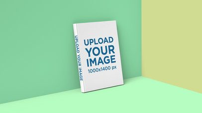 Book Mockup of a Hard-Cover Leaning on the Wall of a Colored Set 2433-el1