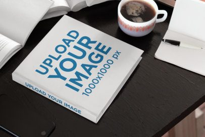 Mockup of a Hardcover Square Book Placed on a Work Desk 33914