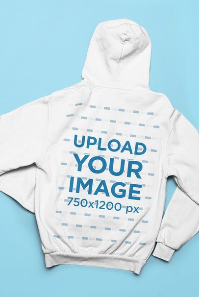 Back-View Mockup of a Hoodie Lying over a Solid Surface 33900