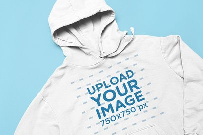 Minimal Closeup Mockup of a Pullover Hoodie Placed on a Plain Color Surface 33902
